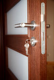 Key. Wood door, lock, open door royalty free stock image
