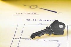 Key. House key on surveyor's lot drawings royalty free stock photo