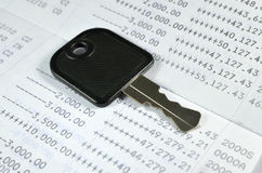 Key on account passbook Royalty Free Stock Photos