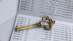 A key on account passbook. Royalty Free Stock Image