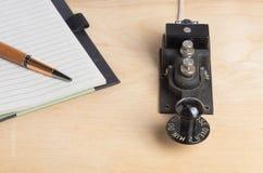 key anteckningsbokpenntelegraf Royaltyfri Bild