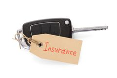 Key attached with insurance tag. Close-up Of Key Attached With Insurance Tag On White Background Stock Images