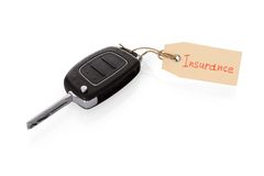 Key attached with insurance tag Stock Photo