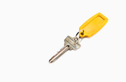 Key attached to a plastic keychain Royalty Free Stock Images