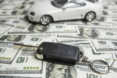 Key from auto to dollars of money. Concept buy purchase car loan stock photography