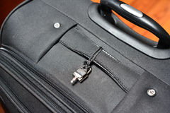 Key and baggage. A key to keep safe and lock the luggauge during the travel Stock Photography
