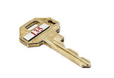 Key from a bank cell. Isolated on a white background Stock Image