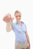 Key being handed over by woman Royalty Free Stock Image
