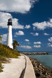 Key Biscayne Lighthouse. View of Key Biscayne lighthouse from the beach in a sunny day with clouds - Miami (USA - 2010 stock photo