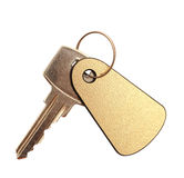 Key with blank golden label Royalty Free Stock Images