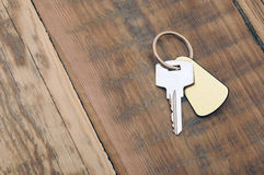 Key with blank golden label Royalty Free Stock Photo