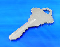 Key on Blue. House Key on Blue Tile Royalty Free Stock Images