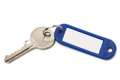 Key with blue trinket isolated Stock Images