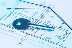 Key on blueprint of new house Royalty Free Stock Image