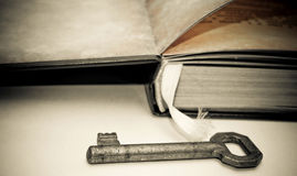Key and book Stock Photos