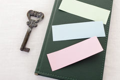 Key and book with post-it notes Royalty Free Stock Image