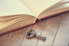 Key and book Stock Images