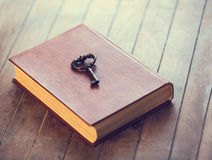 Key and book Stock Photos