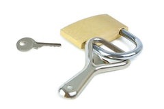 Key and a bottle opener locked to a padlock Stock Photography