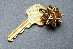 Key with bow Royalty Free Stock Photos