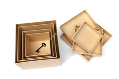 A key in boxes Stock Photos