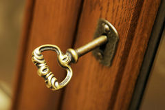 Key in Cabinet Door Stock Photo