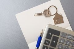 Key, calculator, notebook and pen stock images