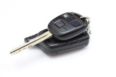 The key from the car with buttons. Lies is isolated on a white background Stock Image