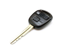 The key from the car with buttons. Lies is isolated on a white background Royalty Free Stock Photo
