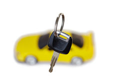 Key from car close up and car in background Royalty Free Stock Images