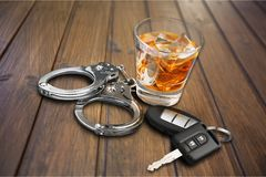 Whiskey with car keys and handcuffs isolated royalty free stock photos
