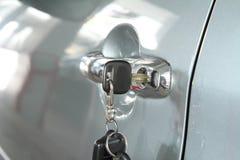 Key at car handle Stock Photos