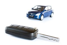 Key & car isolated on the white background Stock Images
