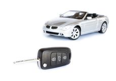 Key & car isolated on the white background Royalty Free Stock Photography