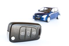 Key & car isolated on the white background Royalty Free Stock Photos