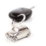 Key car with little key ring in car's shape. Isolated on white background royalty free stock photography