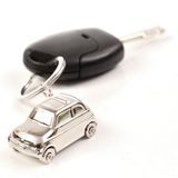Key car with little key ring in car's shape. Isolated on white background stock images
