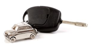 Key car with little key ring in car's shape. Isolated on white background stock photography