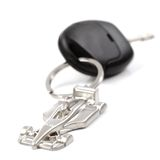 Key car with little key ring in car's shape. Isolated on white background royalty free stock photo