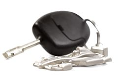Key car with little key ring in car's shape. Isolated on white background stock photo
