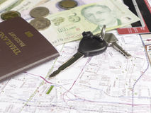 Key car with mobile phone and passport on map Stock Photography