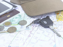Key car with mobile phone and passport on map Stock Photos