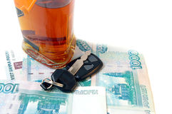 Key from car, money and cognac. Stock Images