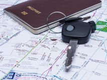 Key from the car and passport on map. Royalty Free Stock Photography