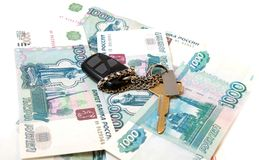 Key from  car and thousand of rubles Stock Images