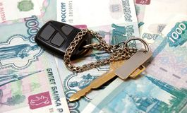 Key from  car and thousand of rubles Royalty Free Stock Images
