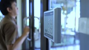 Key card. Man put the key card on machine for open the door stock video footage