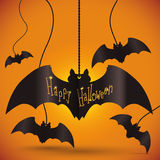 Key Chain Bats in Halloween Poster, Vector Illustration. Happy Halloween key chain bats hanging over the wall on orange background Royalty Free Stock Photo
