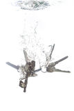 A key chain falling into water Stock Images