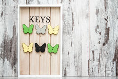 Key Chain Holder on White Wooden Background Royalty Free Stock Photography